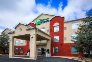 The Holiday Inn Reading Airport is three stories with red and beige exterior walls