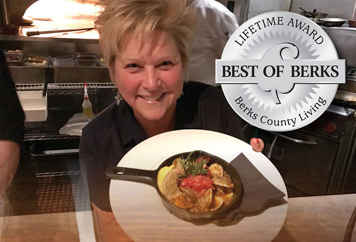 Restaurant owner Judy Henry shoows off one of her many restaurant dishes in the Best of Berks Contest