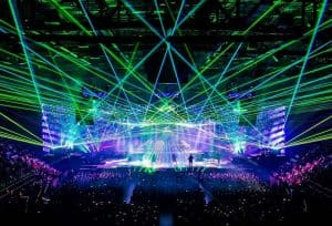 Purple green blue and white laser lights shine out over the crowd at one of the many concerts at Santander Arena in Reading Berks County PA