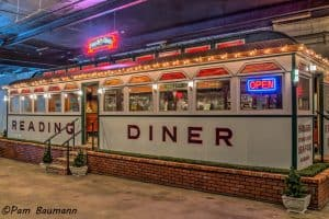 A picture shows th beautifully restored Fegley's Diner car, with the words Reading Diner across the front of the car, sits in the Boyertown Museum of Historic Vehicles.