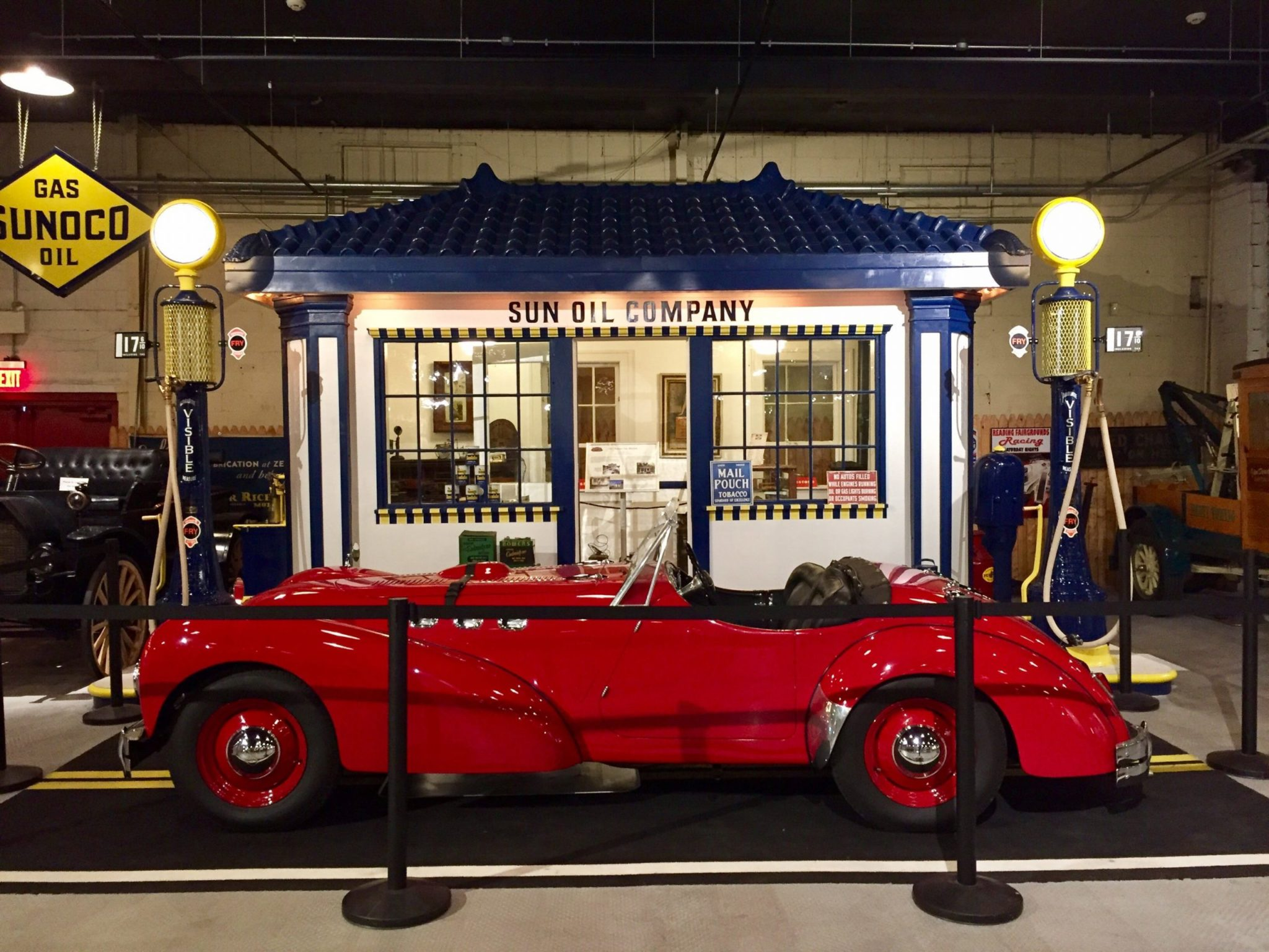 A red antique car in on display at the Boyertown Museum of Historic Vehicles