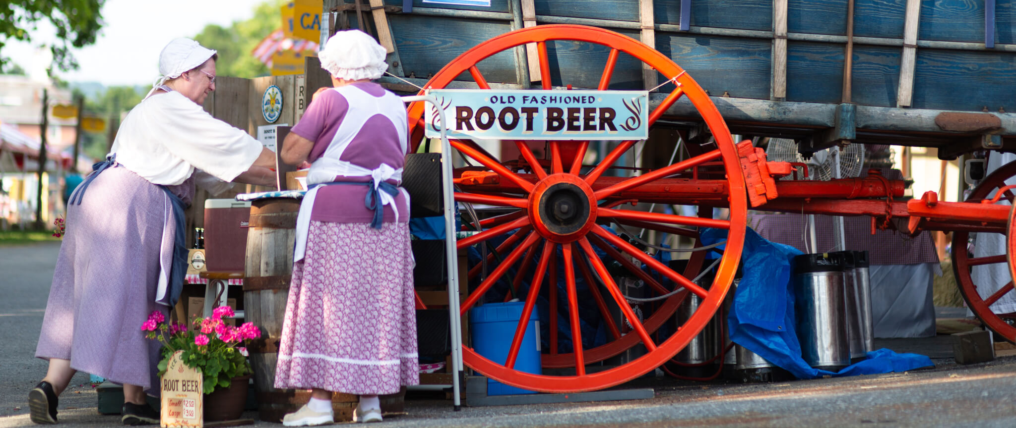 Two ladies at Kutztown Folk Festival serving old fashion root beer