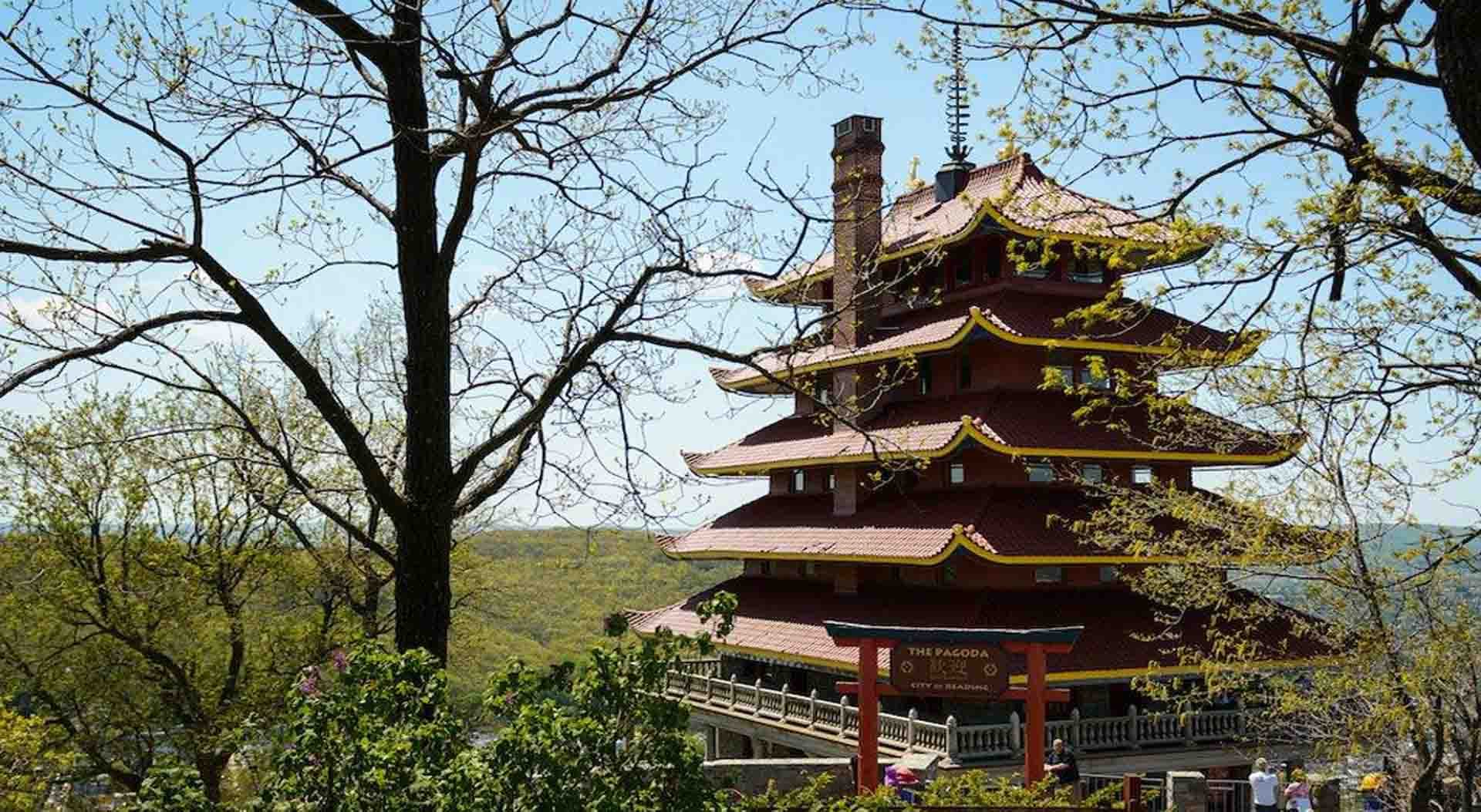 The Pagoda on top of Mount Penn in Reading PA in the spring time with budding trees and blue sky