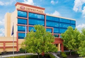 The exterior of the Crowne Plaza in Wyomissing, PA is yellow and orange with blue windows.