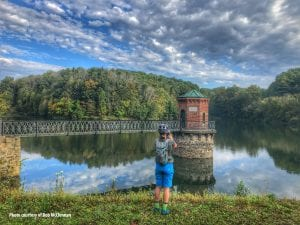 A bike rider takes a photograph of the valve house on Antietam Lake in Berks County, Pennsylvania