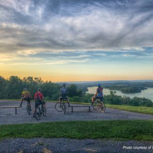 Five bicycle riders take a rest and enjoy the beautiful view of Blue Marsh Lake in Berks County.