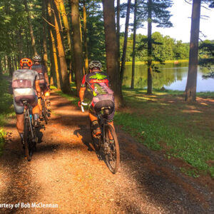 Three bikers ride their bikes on a dirt trail near the Birdsboro Preserve in Birdsboro, PA