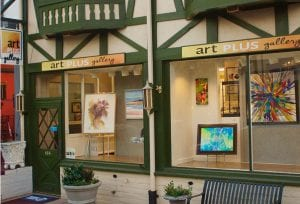 Art work is shown in the front window display of Art Plus Gallery located on Penn Avenue in West Reading, PA in Pennsylvanias Americana Region
