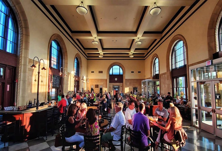 People dining in the Saucony Creek Franklin Street BrewPub. Situated in a renovated Train Station located in Reading, PA in Pennsylvanias Americana Region