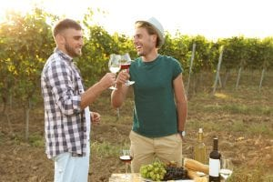 Old friends enjoy wine and food at a special event hosted by a winery along the Berks County Wine Trail.