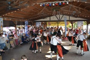 People dancing at Oktoberfest in traditional German garb