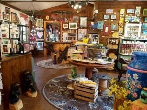 Indoor shot of The Arts Barn in Schuylkill County, PA. Rustic barn room with art and craft items displayed for sale.