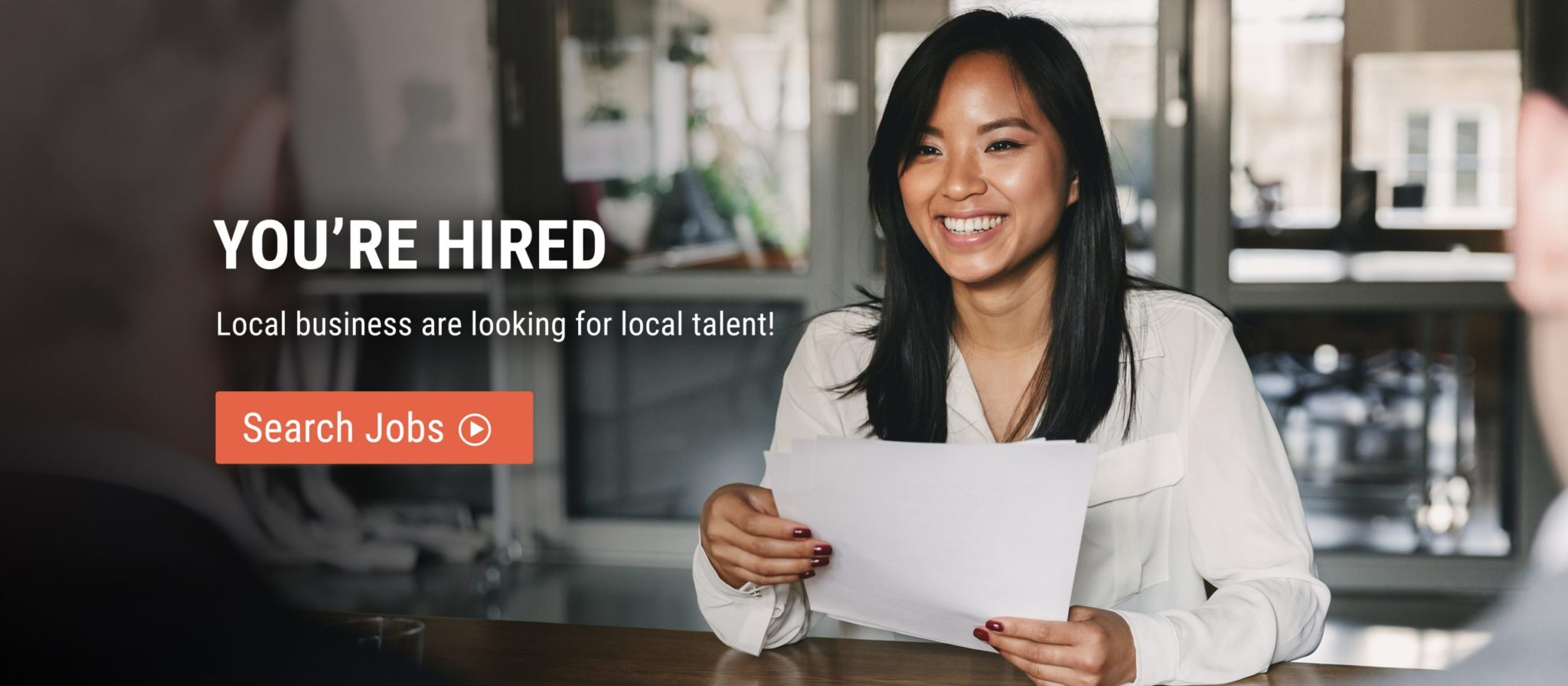 smiling woman on job interview hold resume text saying you're hired